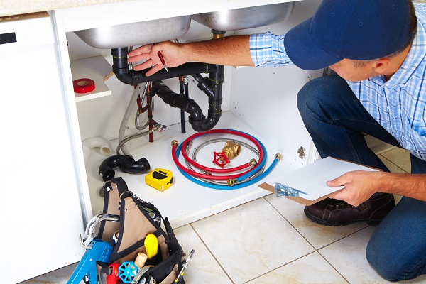 plumber in kitchen